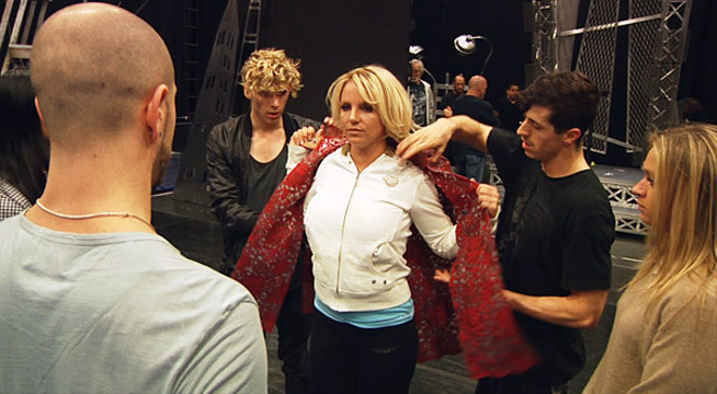 Candid Moments From 'Britney Spears: I Am The Femme Fatale' - In advance of her first tour in over a year, Britney rehearses a costume change with her backup dancers.