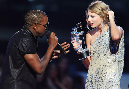 Photos | VMA Moments In Time - 2009 - Kanye West welcomes Taylor Swift to heartbreak at the 2009 MTV Video Music Awards at Radio City Music Hall in New York City.